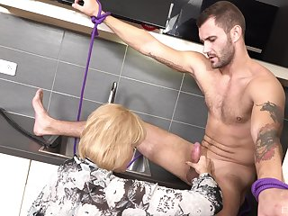 Tied up slave guy gets his cock sucked and a mature rides him
