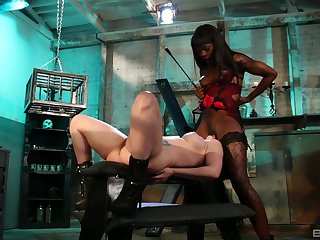 Ebony mistress plays with her slave girl pretty rough