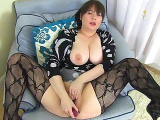 Voluptuous housewife is often masturbating with a purple vibrator, on the couch, in the living room